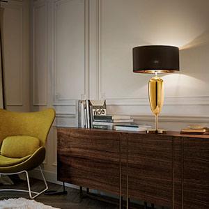 Show Ogiva - schwarz-goldene Textil-Tischleuchte